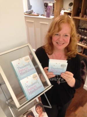 Liz Dean signing copies of her latest book